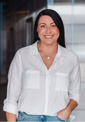 girl with dark hair in white shirt